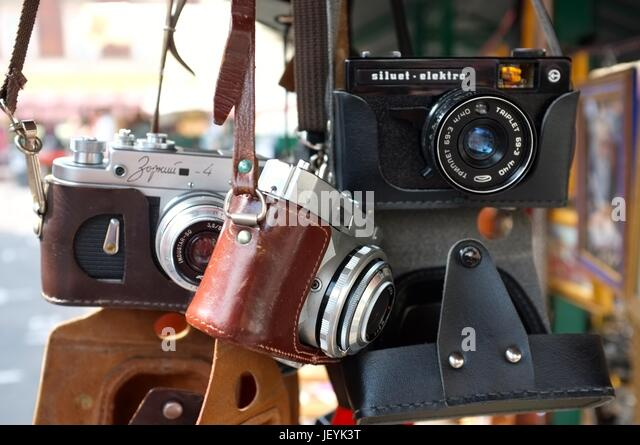 Old-fashioned cameras hanging from a stall in the Old Jewish Quarter of Krakow, Poland, Central/Eastern Europe, - Stock Image