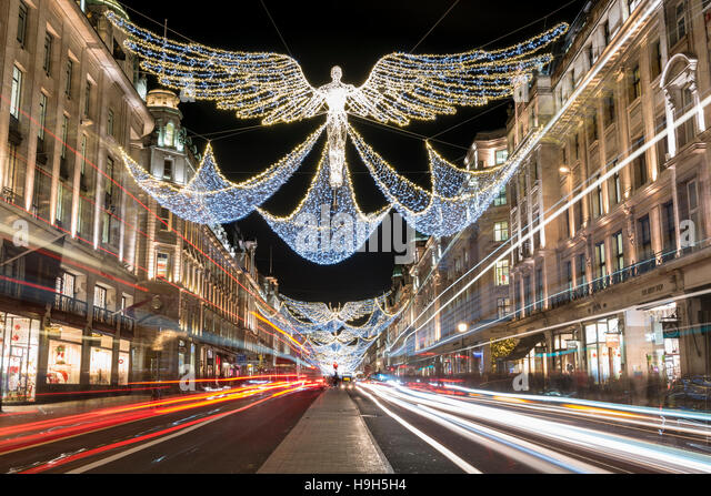 London, UK.  23 November 2016.  The annual Christmas Lights are seen in Regent Street, as traffic passes by. Credit: - Stock Image