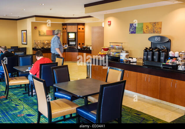 Illinois Champaign Fairfield Inn & Suites motel hotel lobby breakfast room free included chairs tables - Stock Image