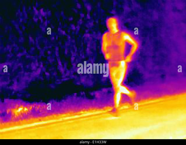 Front view thermal photograph of young male athlete running. The image shows the heat of the muscles - Stock Image