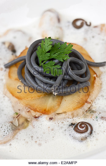 France, Finistere, Brest, and Sailor shell parsnip cake, vegetable tagliatelle recipe Yvon Morvan restaurant, The - Stock Image
