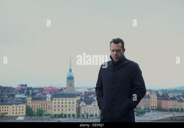 Portrait of Man with Stockholm Cityscape in Background - Stock Image