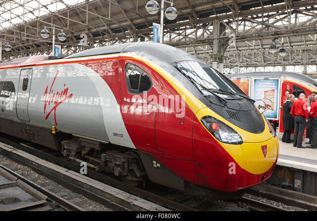 virgin trains 390137 pendolino train at Piccadilly train station Manchester UK - Stock Image