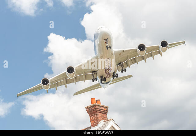 Airbus A380 on a low banked approach before landing at an aviation trade event. - Stock Image