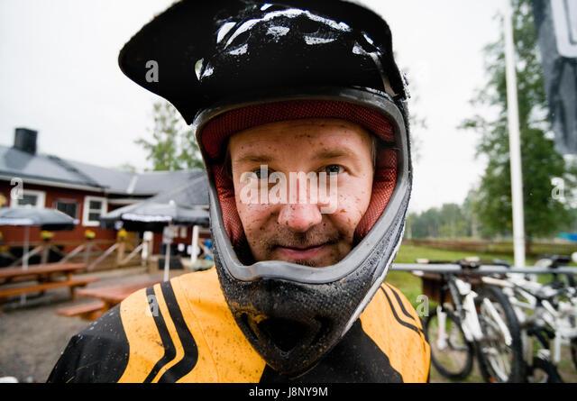 Portrait of man wearing safety helmet - Stock-Bilder