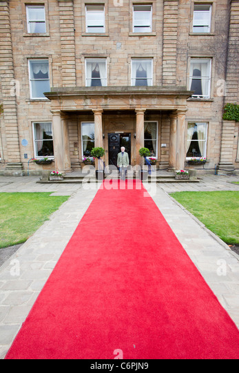 A red carpet leading towards Walton Hall near Wakefield, Yorkshire, UK. - Stock Image
