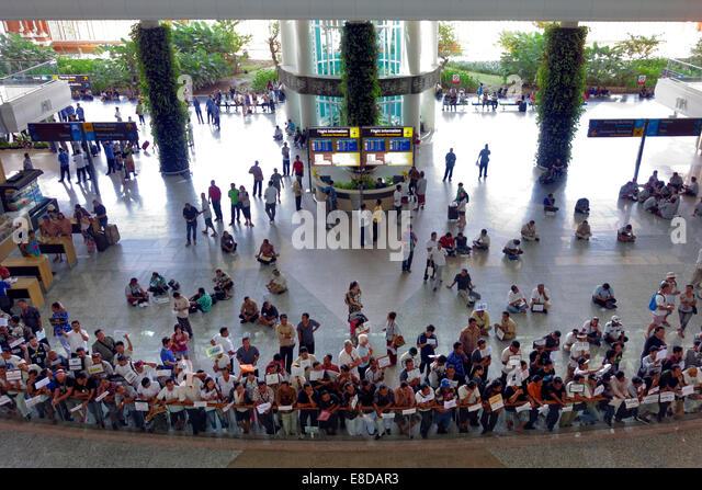 Concourse, arrival with waiting greeters, Ngurah Rai Airport or Denpasar International Airport, Tuban, Bali, Indonesia - Stock Image