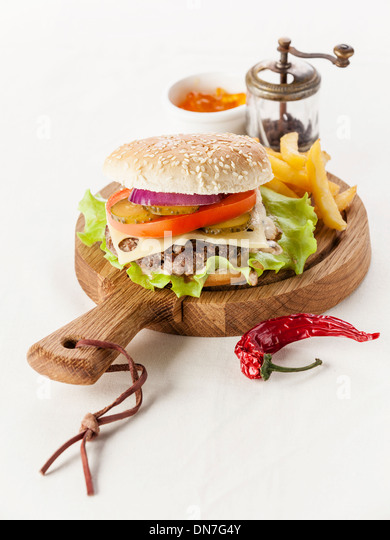 Burger with meat and greens and Salted french fries - Stock Image