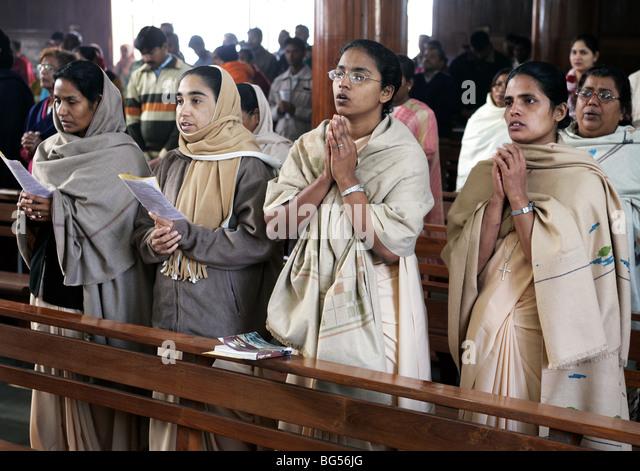 catholic nuns at sunday mass service in the roman catholic cathedral Saint Joseph's in Lucknow, Uttar Pradesh, - Stock-Bilder