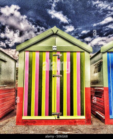 Candy stripe beach hut at seaside - Stock Image