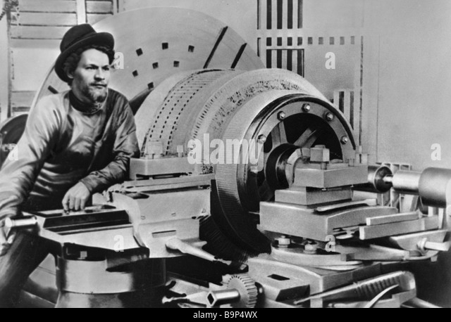 Mikhail Kalinin near his lathe at the Volta plant in Tallinn - Stock Image