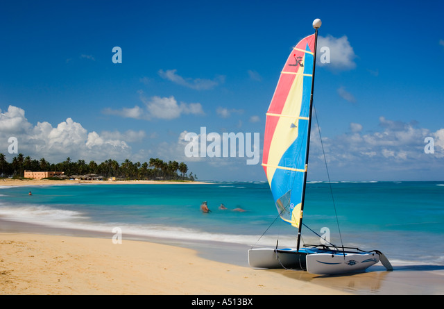 Colourful catamaran on the beach at Uvero Alto near Playa Del Macao and Punta Cana in Dominican Republic. - Stock Image