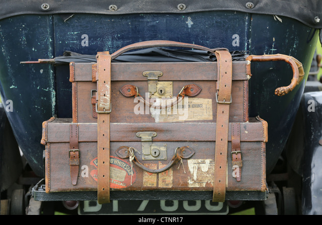Leather luggage on the back of a vintage car - Stock Image