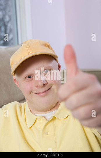 Man showing Thumbs Up sign - Stock Image