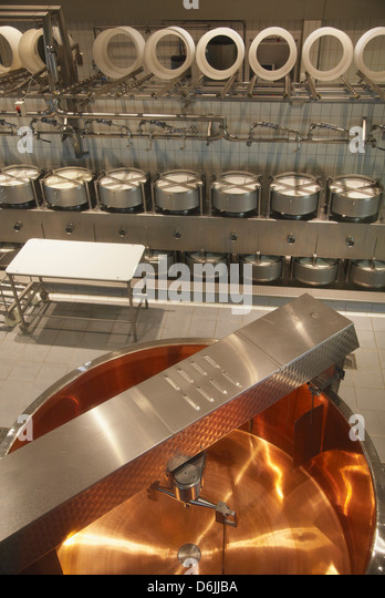Cheese making equipment inside La Maison du Gruyere, Gruyeres, Fribourg, Switzerland, Europe - Stock Image