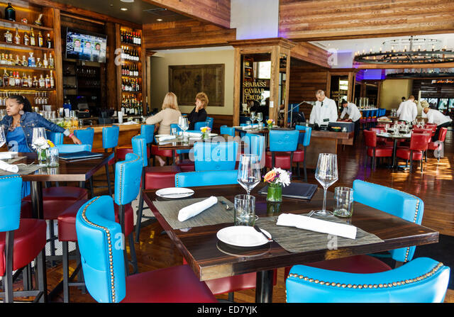 Chicago Illinois River North downtown North Dearborn Street Joe Fish seafood restaurant inside interior tables - Stock Image