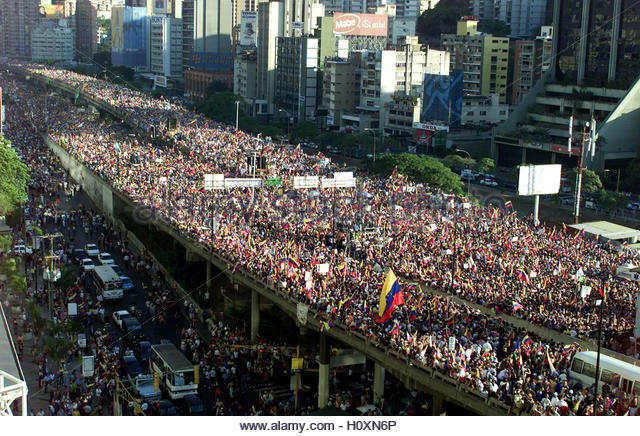 Hundreds of thousands of Venezuela's anti-government protesters march  in support of private media in Caracas, - Stock Image