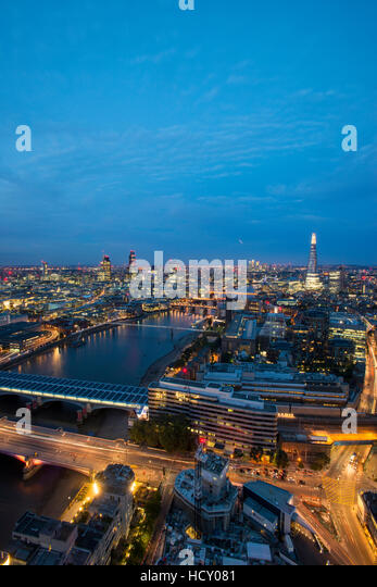 A night-time view of London and the River Thames from the top of the Southbank Tower, London, UK - Stock Image