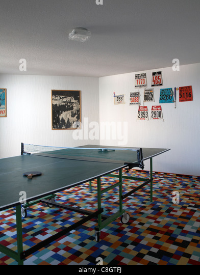 Interior with ping pong table with rackets - Stock Image
