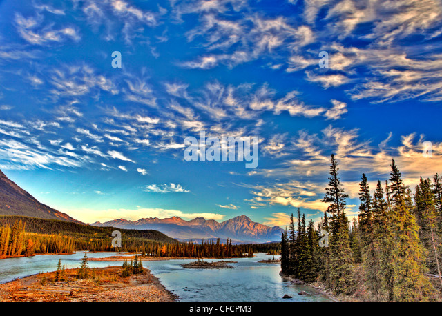 Cirrus Clouds over Athabasca River, Jasper National Park, Alberta, Canada - Stock Image
