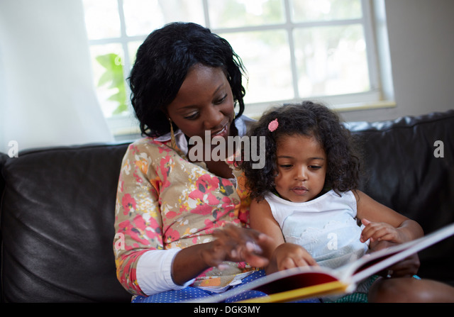 Mother and daughter reading story - Stock Image