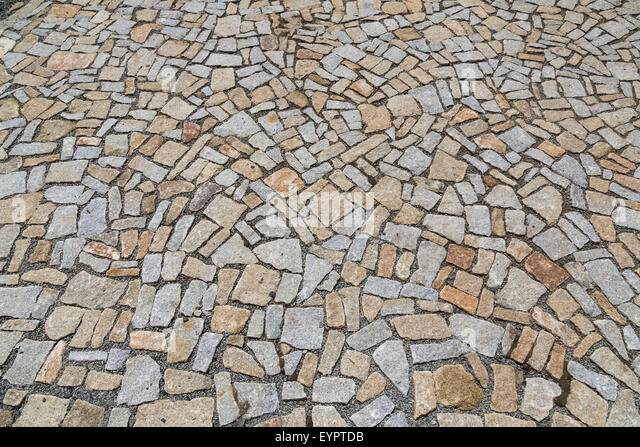 The stone pavement as the background texture, Stone block road pavement - Stock Image
