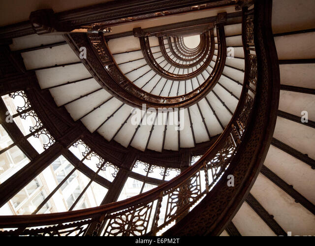 The brilliant oriel staircase at The Rookery, one of the most historically significant buildings in Chicago. - Stock Image