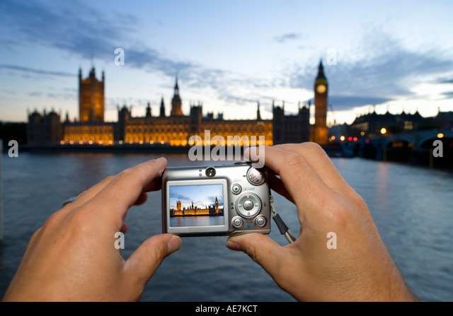 Tourist Taking Digital Image of Houses Of Parliament, London - Stock Image