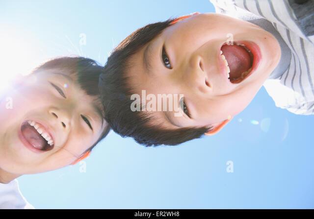 Happy Japanese kids laughing - Stock Image