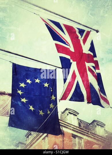 The Union Jack & the European Union flags flying side by side. - Stock Image