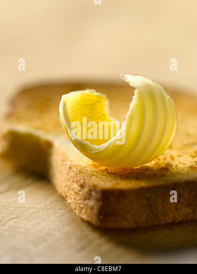 Knob of butter on a biscotte - Stock Image