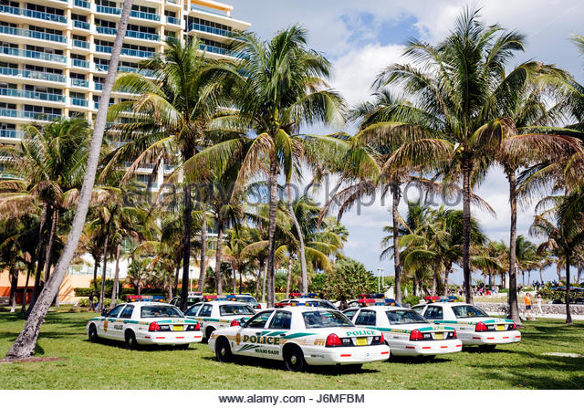 Miami Beach Florida Lummus Park police cars - Stock Image