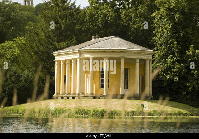 The Music Temple on an island in the lake at West Wycombe Park, Buckinghamshire. The temple has a Doric colonnade, - Stock-Bilder