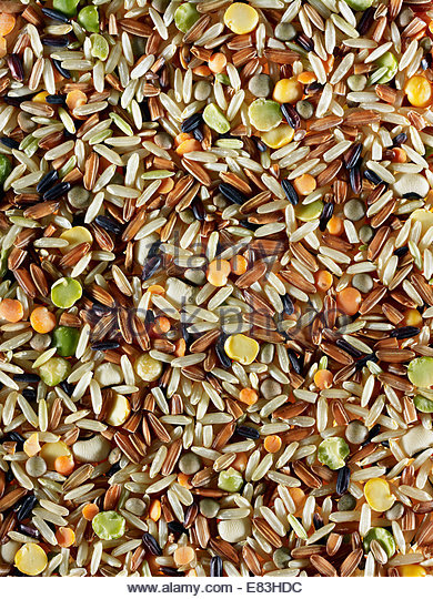 Colorful image of raw wild rice as texture background - Stock Image