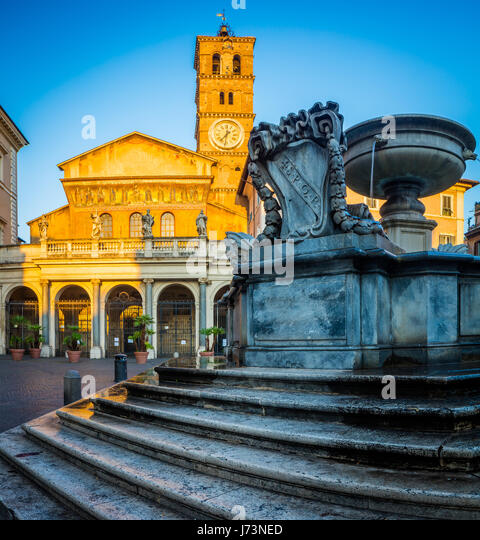 Piazza di Santa Maria and Basilica di Santa Maria in the Trastevere part of Rome, Italy - Stock Image