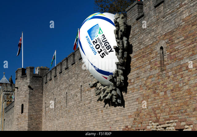 Giant rugby ball crashed into the wall of Cardiff Castle to mark the opening of the 2015 Rugby World Cup, South - Stock-Bilder