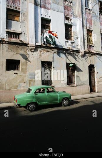 Cuba, Havana, Old car parked on street - Stock Image
