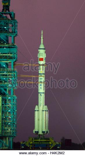 Jiuquan, China. 17th Oct, 2016. The 2 astronauts go into space with Long March II F launch vehicle been carried - Stock Image