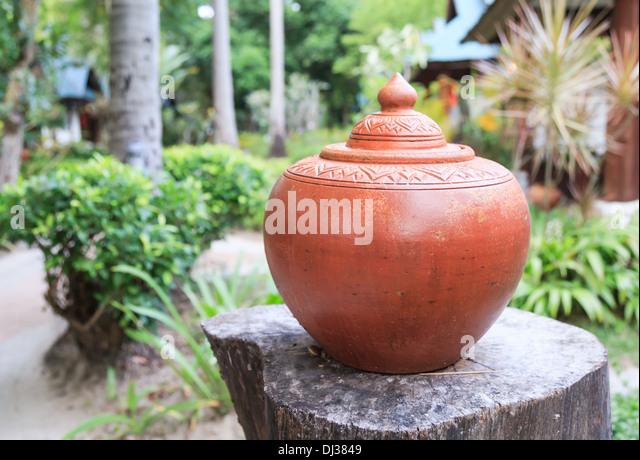 Thai water earthen jar in the resort - Stock Image