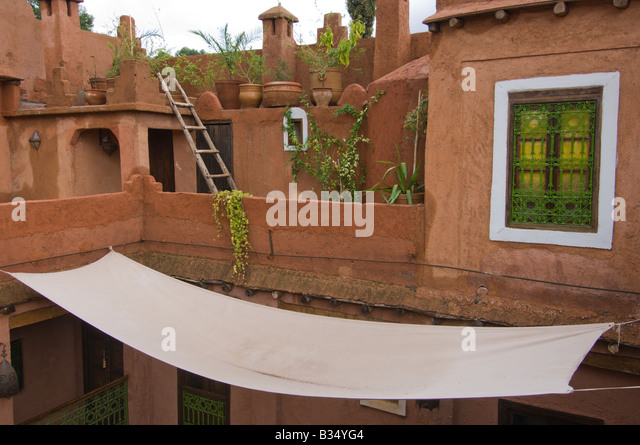 Screened window in the roof top level of a Ryad, traditional Berber building made of clay, Atlas mountains, Morocco - Stock Image