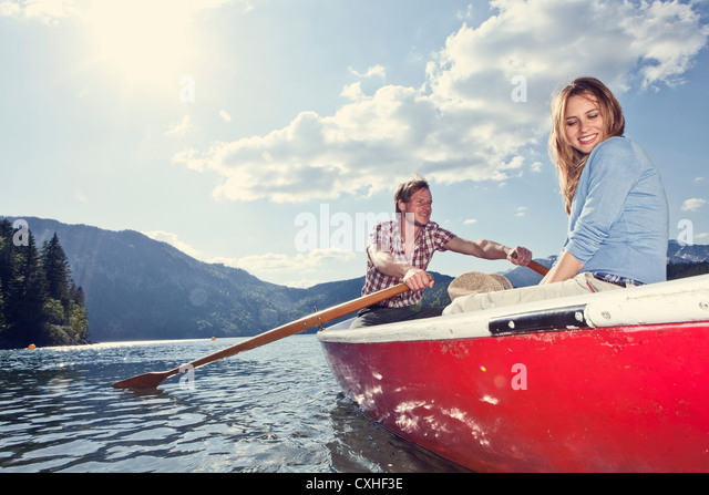 Germany, Bavaria, Couple in rowing boat, smiling - Stock Image