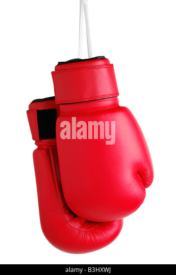 Boxing Gloves Hanging by Their Laces Against a White Background - Stock Image