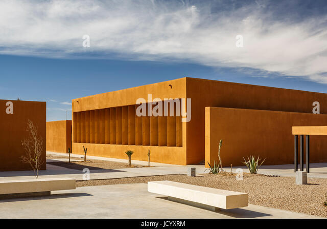 View towards landscaped square and buildings. Laayoune Technology School, Laayoune, Morocco. Architect: Saad El - Stock-Bilder