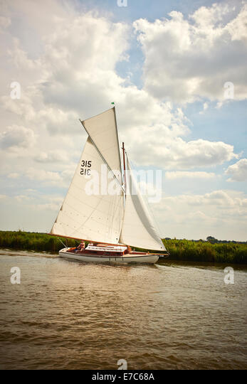 A Classic Gaff Rigged Norfolk Broads River Cruiser Yacht with a Topsail, The River Bure, Norfolk Broads, Norfolk, - Stock Image