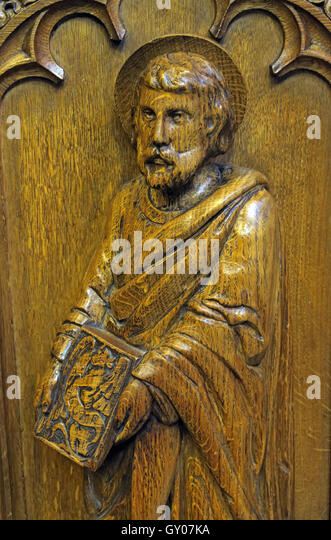 St Wilfrids Church Grappenhall- Pulpit wood carving of apostle, Warrington - Stock Image