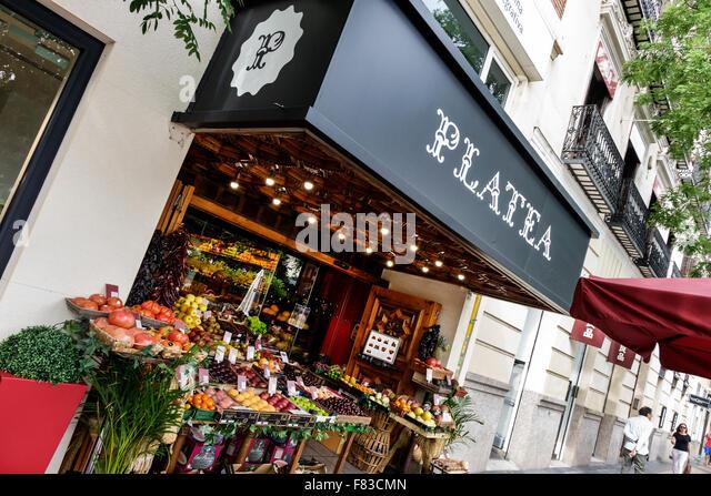 Spain Europe Spanish Hispanic Madrid Salamanca Calle de Goya Platea Madrid produce fruit sale vendor store front - Stock Image