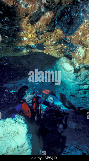 underwater cave diver near cave mouth risk - Stock Image