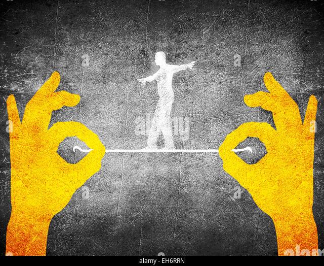 orange hands and tightrope walker - Stock-Bilder