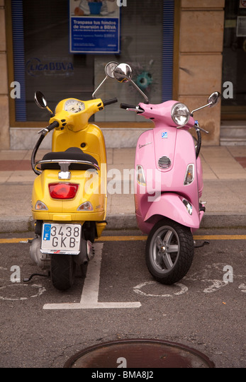 Two Vespa scooters parked in Oviedo Spain - Stock-Bilder