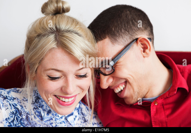 Young couple, face to face, smiling - Stock Image